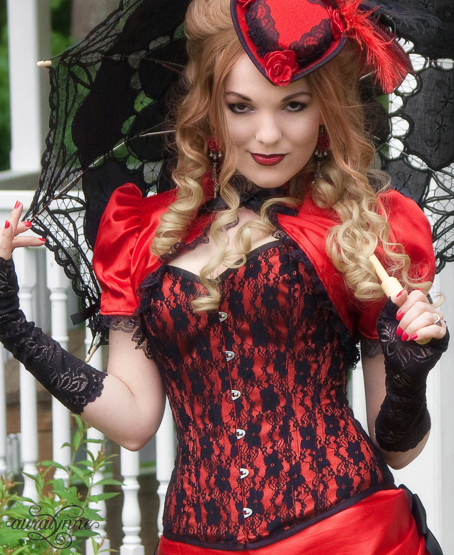 A red satin and black lace overbust corset