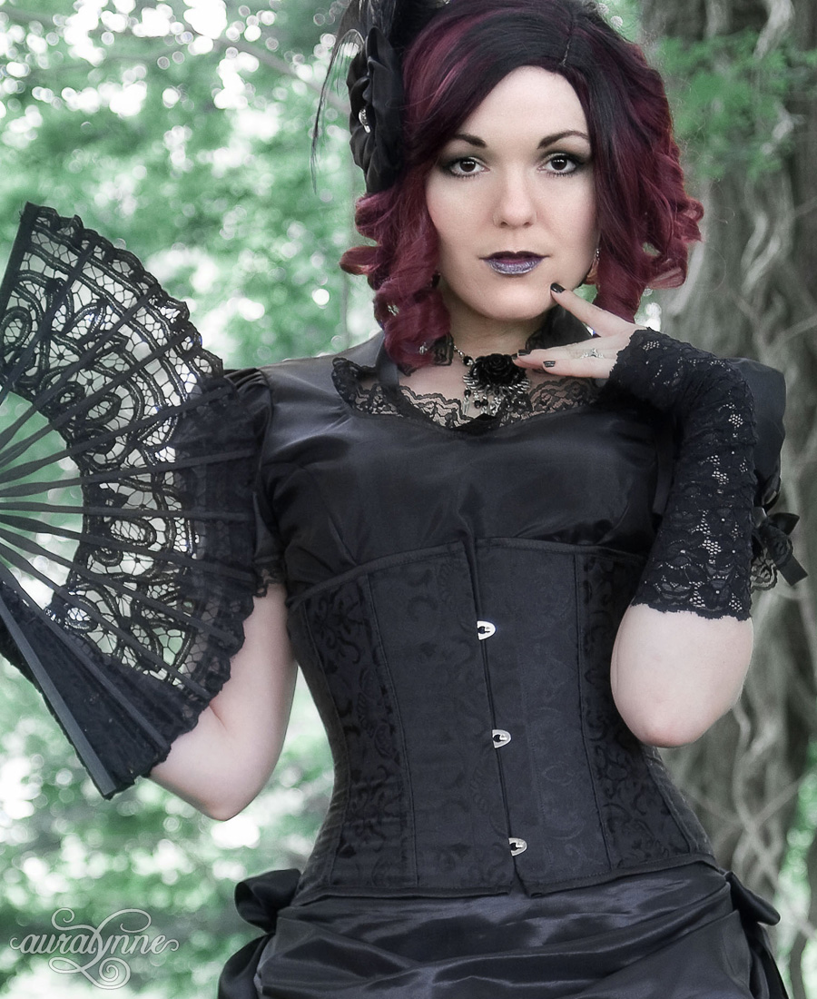 An underbust corset in black