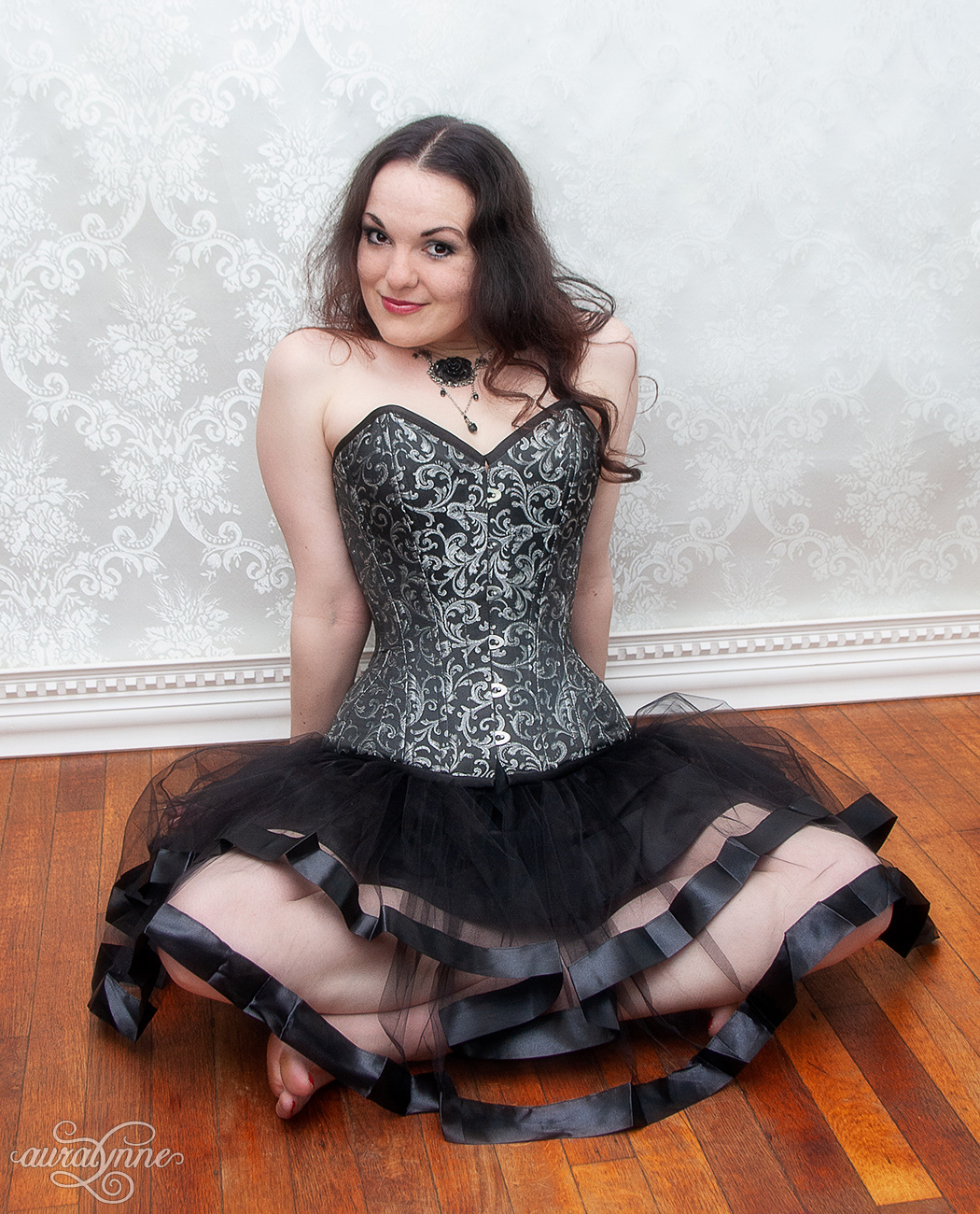 Sitting cross legged in a corset