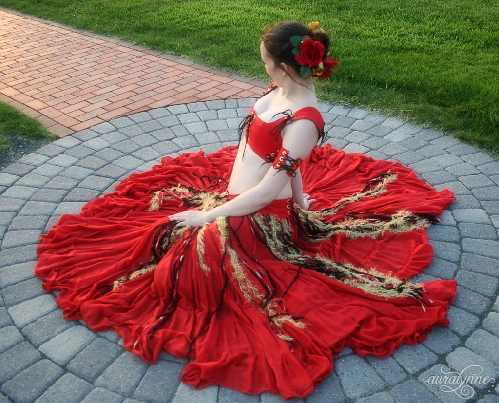 Sitting in Red Renaissance Belly Dance Costume