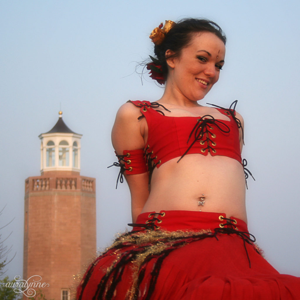 Belly dancer with light house
